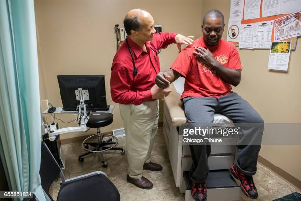 Dr James Jackson MD examines Matthew Shorter a medicaid patient enrolled in the Healthy Indiana Plan at the Heart City Health Center on Thursday June...
