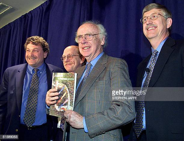 Dr James Watson founder of the Human Genome Project holds up a copy of Nature magazine as he and Dr Eric Lander of the Whitehead Institute for Genome...