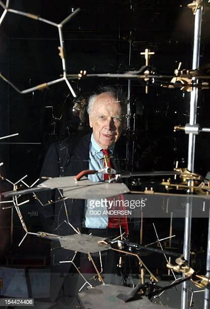 Dr James Watson poses with the original DNA model ahead of a press conference at the Science museum in London 20 May 2005 Dr Watson discovered the...