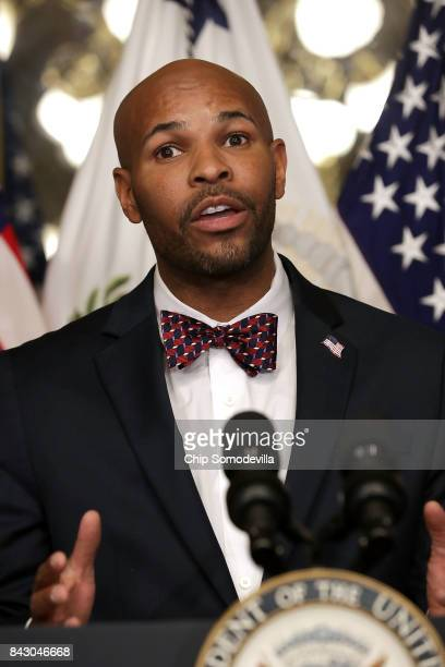 Dr Jerome Adams delivers remarks after being sworn in as US Surgeon General during a ceremony in the Eisenhower Executive Office Building September 5...