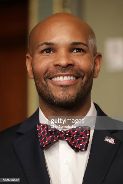 Dr Jerome Adams prepares to be sworn in as US Surgeon General during a ceremony in the Eisenhower Executive Office Building September 5 2017 in...