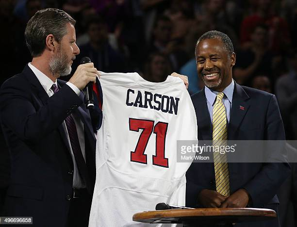Dr Jerry Falwell President of Liberty University presents US Republican President candidate Dr Ben Carson with a jersey during a campaign rally at...