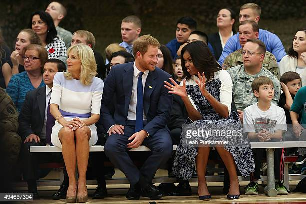 Dr Jill Biden Prince Harry and First Lady Michelle Obama attend a Wounded Warriors basketball game to highlight Joining Forces Initiative and the...