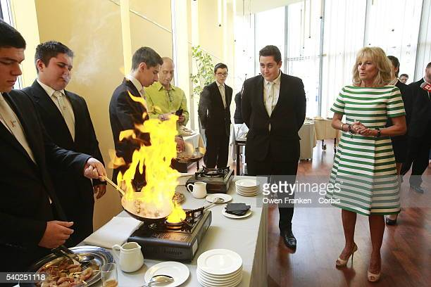 Dr Jill Biden watches a demonstration of flambaing as she meets with students and staff during a visit to the Lycée Hôtelier Guillaume Tirel on June...
