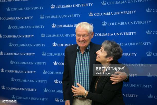 Dr Joachim Frank of Columbia University poses with his wife Carol Saginaw during a press conference after being awarded the Nobel Prize in Chemistry...