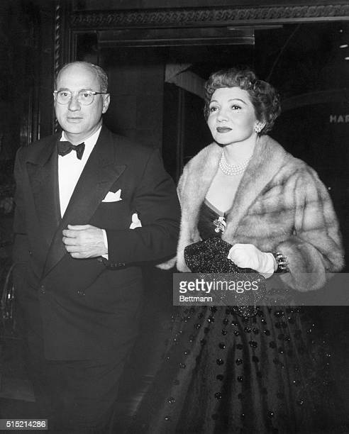 Dr Joel Pressman and Claudette Colbert entering the Beverly Wilshire Hotel to attend the party Louis B Mayer gave in honor of Henry Ford II and Mrs...
