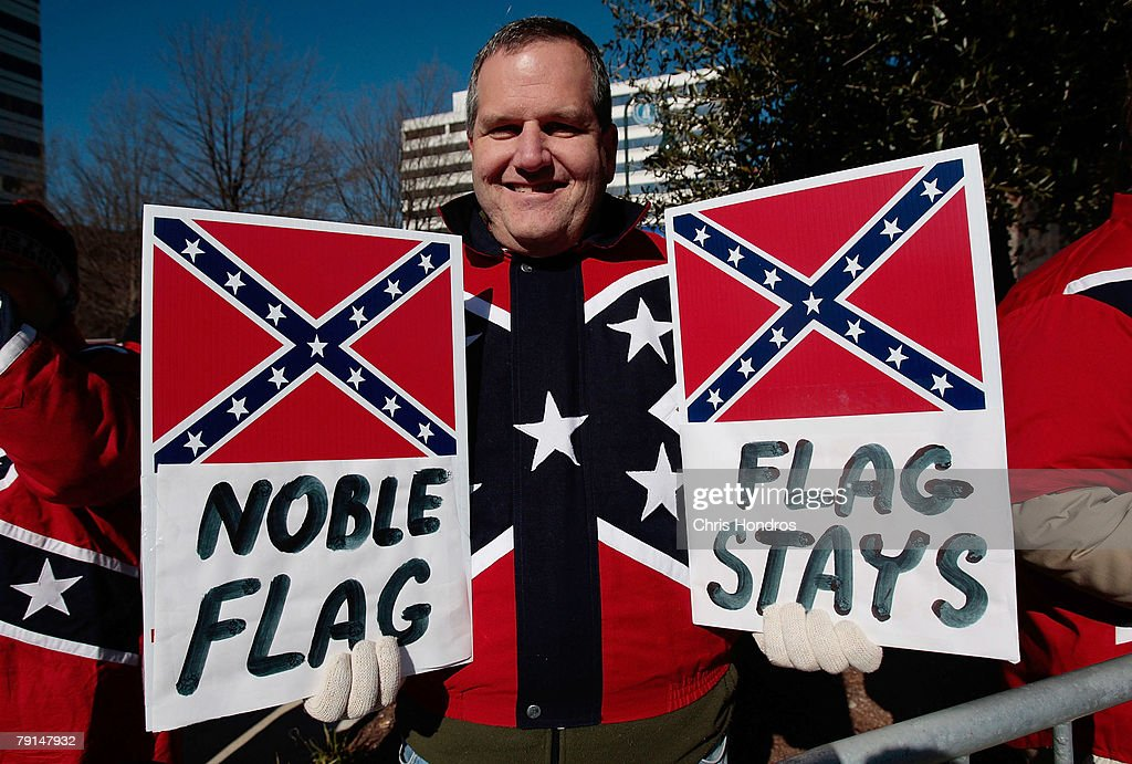 Dr. John Cobin of Greenville, South Carolina holds signs in support of displaying the Confederate flag at a Martin Luther King Day rally January 21, 2008 in Columbia, South Carolina. Cobin is a member of the League of the South, a Southern nationalist organization. All three major Democratic candidates for President spoke to a large crowd on the state house grounds.
