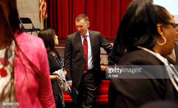 LOS ANGELES CA AUGUST 5 2014 Dr John E Deasy center Superintendent of Schools for Los Angeles Unified School District visits with LAUSD...