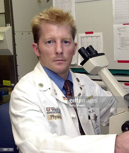 Dr John McDonald a Washington University neurologist works with stem cell research equipment in his laboratory September 12 2002 in St Louis Missouri...