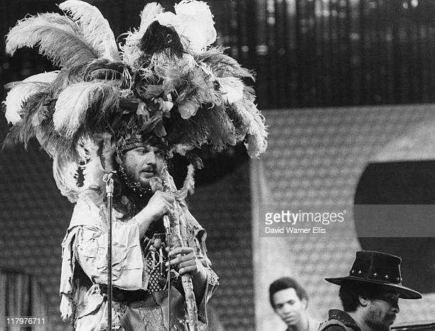 Dr John US singersongwriter wearing a feather headdress while singing into a microphone during a live concert performance on stage at the Montreux...