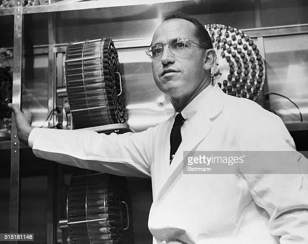 Dr Jonas Salk stands in the University of Pittsburgh laboratory in which he developed a vaccine for polio