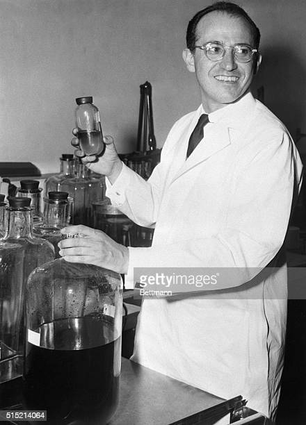 Dr. Jonas Salk stands in the University of Pittsburgh laboratory where he works on perfecting his vaccine for polio