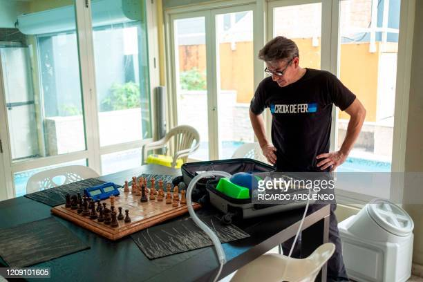 Dr Jonathan Alistair looks at a prototype of a mechanical ventilator that he is currently working on in his house is seen in San Juan Puerto Rico on...