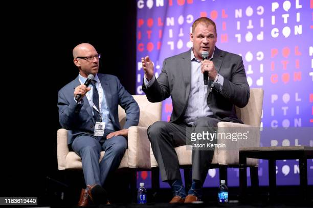 Dr Jonathan Metzl and Mayor Glenn Jacobs speak onstage during the 2019 Politicon at Music City Center on October 26 2019 in Nashville Tennessee