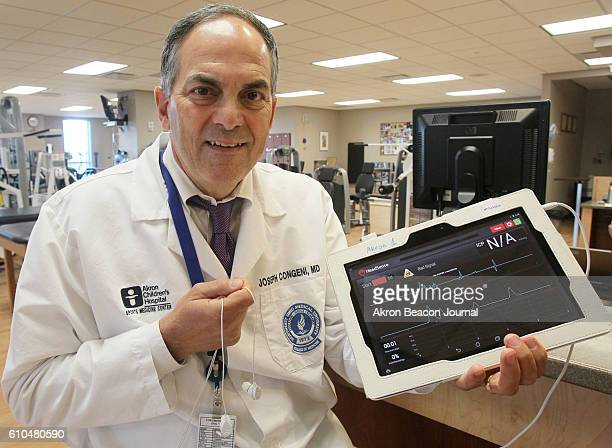 Dr Joseph Congeni director of sports medicine at Akron Children's Hospital with the HeadSense ICP monitor which is a platform for a noninvasive brain...