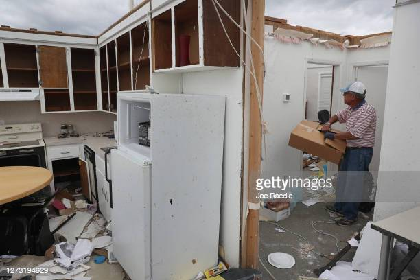 Dr Joseph Mirabile salvages what he can after the roof was blown off of his real estate business when Hurricane Sally passed through the area on...