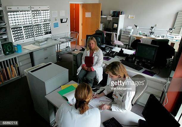 Dr Julie Brahmer and Katie Thornton review the results of PET scans shown in background of a patient being treated at the Kimmel Comprehensive Cancer...