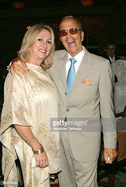 Dr. Julio Iglesias Puga and Liane Rodriguez pose at Carlos Iglesias' 60th birthday celebration on April 30, 2005 at the Ocean Club in Key Biscayne,...