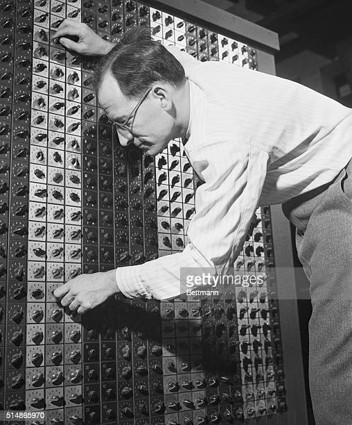 Dr JW Mauchly prepares the ENIAC electronic calculating machine to solve a mathematical problem The ENIAC developed by the University of...