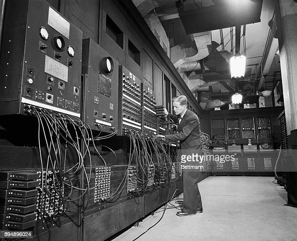 Dr JW Mauchly with the electronic computing machine known as the ENIAC