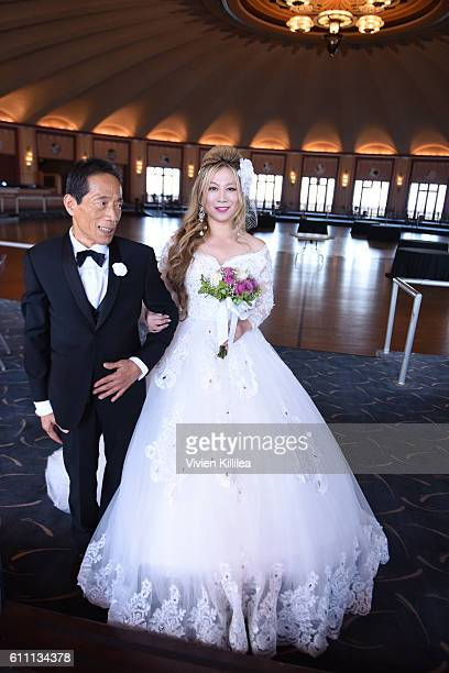 Dr Kaneko and Alice Aoki attend the Aoki wedding ceremony at the Avalon Ballroom on September 25 2016 on Catalina Island California