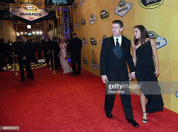 Dr Kate Edwards and her husband NASCAR Sprint Cup Series driver Carl Edwards arrive at the 2014 NASCAR Sprint Cup Series Awards at Wynn Las Vegas on...