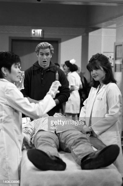 YEARS 'Dr Kelly' Episode 10 Air Date Pictured Diana Tanaka as Doctor Wong MarkPaul Gosselaar as Zack Morris Tiffani Thiessen as Kelly Kapowski Photo...