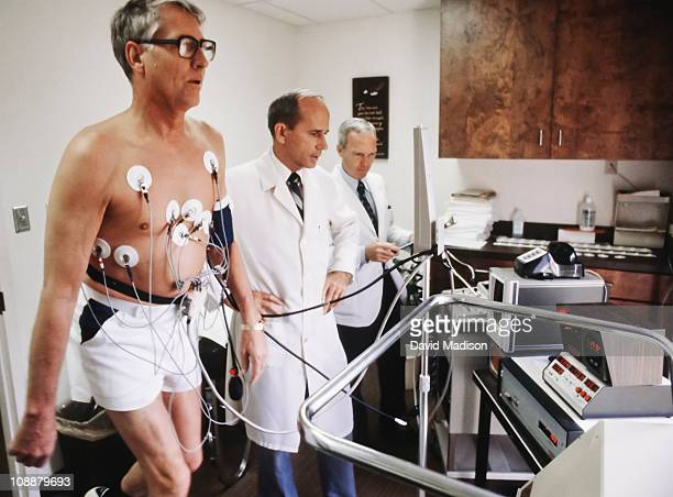 Dr Kenneth H Cooper center conducts a treadmill test at the Cooper Aerobics Center in September 1980 in Dallas Texas Cooper published the bestselling...