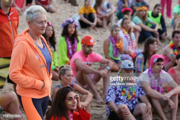 Dr Kerryn Phelps attends birthday celebrations for OneWave at sunrise on Bondi Beach on March 22 2019 in Sydney Australia Surfers gather to celebrate...