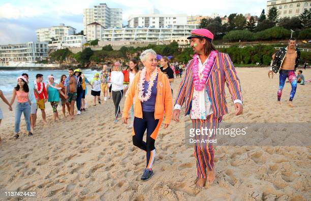 Dr Kerryn Phelps chats with OneWave founder Grant Treblico on the Bondi Beach shoreline on March 22 2019 in Sydney Australia Surfers gather to...