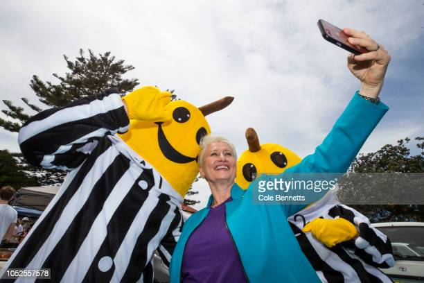 Dr Kerryn Phelps stops for a selfie with the Bananas in Pyjamas costumed campaigners as part of the Save the ABC push on October 20 2018 in Sydney...