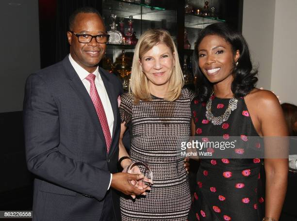 Dr Kevin Holcomb and Honoree Dr Laura Forese and Dr Janna Andrews attend the 'Kicked it in Heels' Cancer Fundraiser at Beautique on October 18 2017...