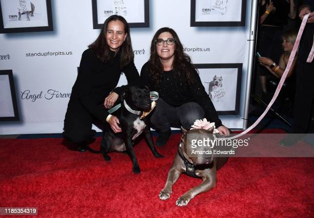 Dr. Kim Carey, DVM and Rebecca Corry arrive with Sally and Todd the Pitbulls at the 9th Annual Stand Up For Pits event hosted by Kaley Cuoco at The...