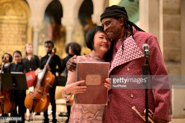 Dr Kim Phc and Hannibal Lokumbe share a hug after the composer performed his 1973 composition Children of the Fire for the first time in the presence...