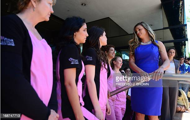 Dr Kristi Funk turns away after briefly addressing the media outside the Pink Lotus Breast center in Beverly Hills California on May 14 where...