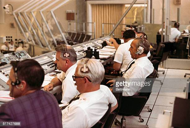 Dr Kurt H Debus Director Kennedy Space Center participates in Apollo 11 countdown demonstration test within the launch control center's firing room...