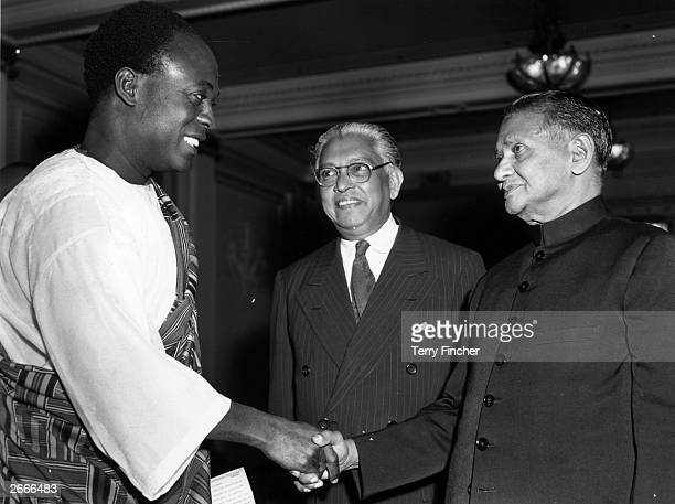 Dr Kwame Nkrumah , prime minister of Ghana, shaking hands with the Ceylon minister of justice M W H de Silva, as Sir Claude Corea, high commissioner...