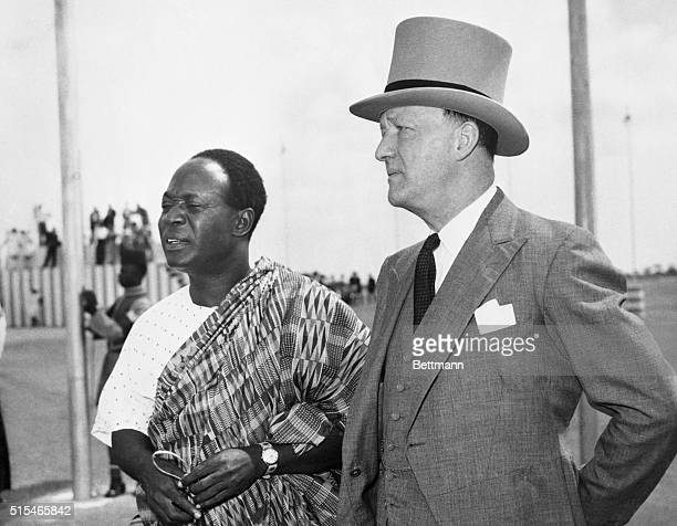 Dr. Kwame Nkrumah , Prime Minister of the Gold Coast, welcomes British Home Secretary R.A Butler, after the latter arrived here to attend the Gold...