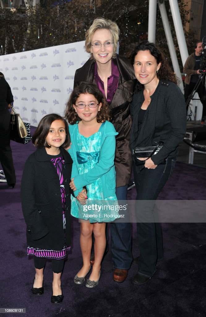 Dr. Lara Embry, actress Jane Lynch and children arrive at the premiere of Paramount Pictures' 'Justin Bieber: Never Say Never' held at Nokia Theater L.A. Live on February 8, 2011 in Los Angeles, California.