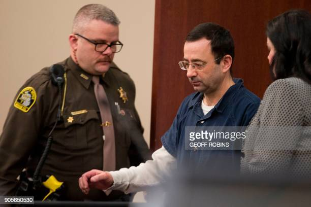 Dr Larry Nassar is led into court during his sentencing hearing in Lansing Michigan January 16 2018 The former Team USA gymnastics doctor is...