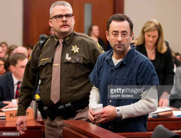 Dr Larry Nassar is led to the witness box during his sentencing hearing in Lansing Michigan January 16 2018 The former Team USA gymnastics doctor is...
