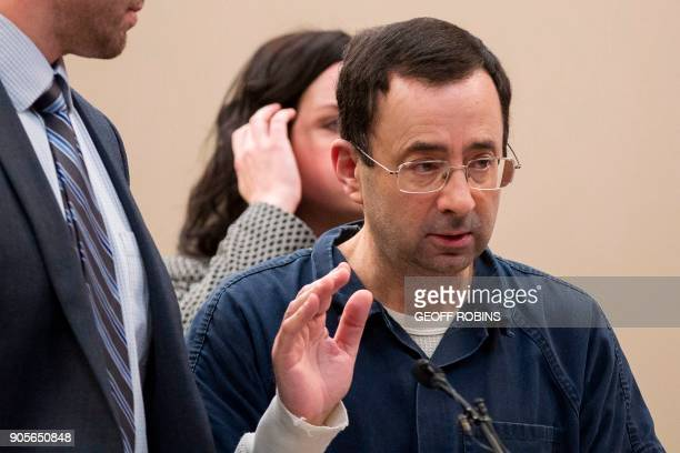 Dr Larry Nassar raises his hand in court during his sentencing hearing in Lansing Michigan January 16 2018 The former Team USA gymnastics doctor is...