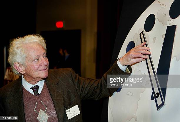 Dr Leon Lederman an internationally renowned highenergy physicist adjusts the hands on the Doomsday Clock two minutes closer to midnight 27 February...