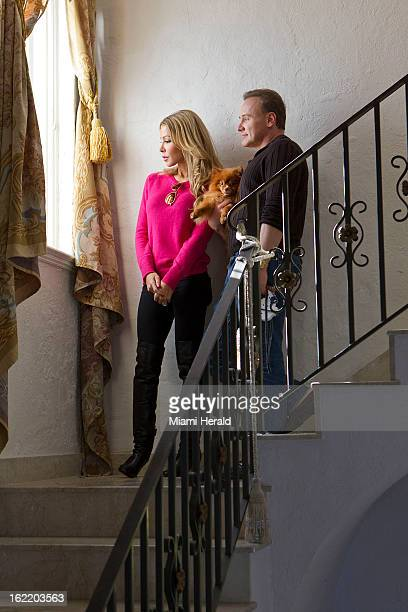 Dr Leonard Hochstein right and his wife Lisa Hochstein of The Real Housewives of Miami take in the view from a window in a mansion on Star Island...