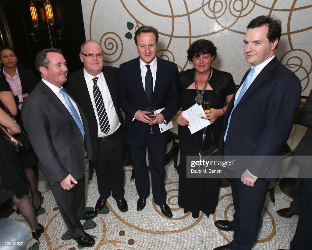 Dr. Liam Fox, Andy Harris, David Cameron, Denise Harris and George Osborne show armed forces support at the 'Give Us Time' fundraiser held at Corinthia Hotel London on November 14, 2012 in London, England.