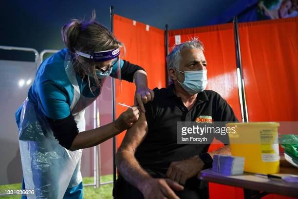 Dr Lisa Pickles administers the Pfizer-BioNTech COVID-19 vaccine to circus technical adviser Bruno Antares who was the first person to be vaccinated...