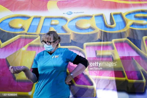 Dr Lisa Pickles mixes the Pfizer-BioNTech COVID-19 vaccine at a new 'Pop Up' vaccination centre in the Big Top of Circus Extreme in Shibden Park on...