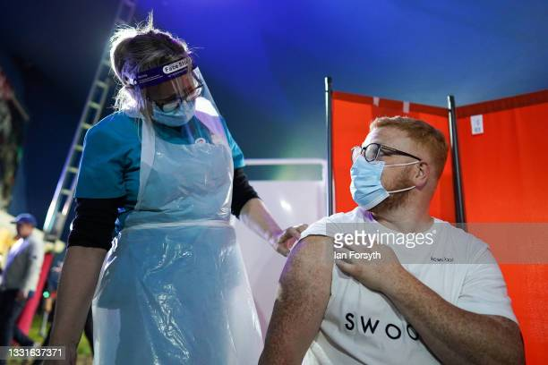 Dr Lisa Pickles prepares to vaccinate Ben Fleming from Halifax at a new 'Pop Up' vaccination centre in the Big Top of Circus Extreme in Shibden Park...