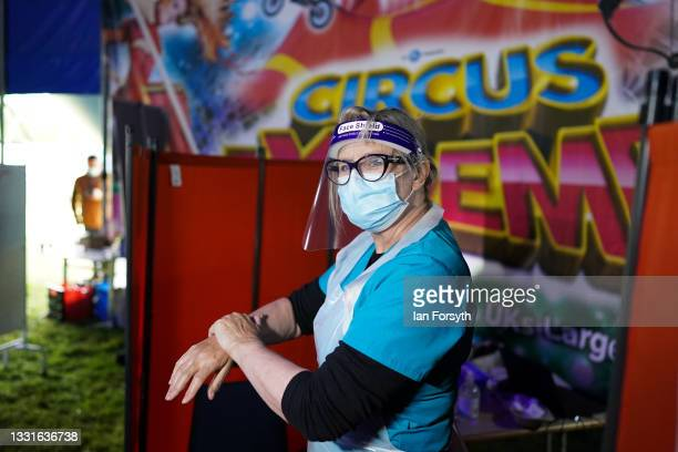 Dr Lisa Pickles sterilises her hands before administering Covid 19 vaccinations at a new 'Pop Up' vaccination centre in the Big Top of Circus Extreme...