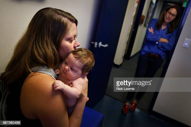 MONICA CA OCTOBER 8 2014 Dr Lisa Stern right a pediatrician talks with Christa McCaffrey of Santa Monica about her 2month old Olive McCaffrey who...